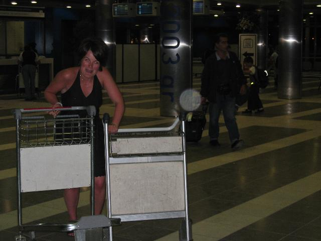 Helen tries to manage two trollies
